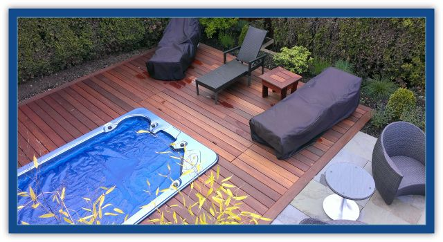 Hardwood deck with furniture and pool